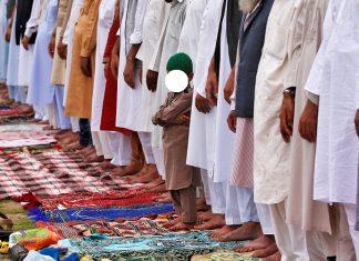 A Muslim boy looks on as he attends the Eid al-Fitr prayers in Srinagar